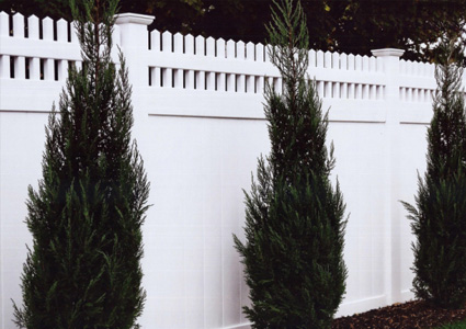 White vinyl fencing with trees